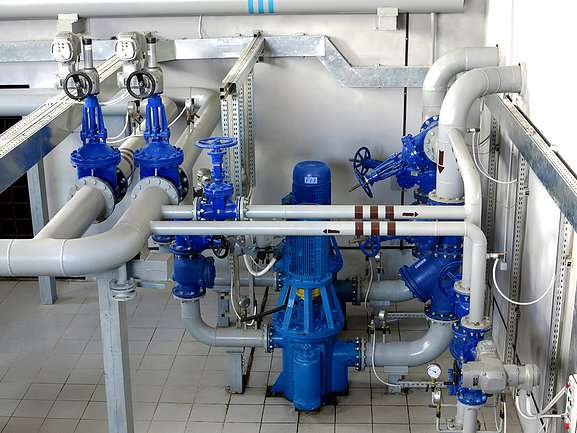 Water pumping station, industrial interior and pipes. Water system valves, electronic motor control water supply